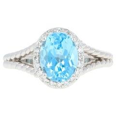 Blue Topaz and Diamond Halo Ring, 14 Karat White Gold Oval 2.66 Carat