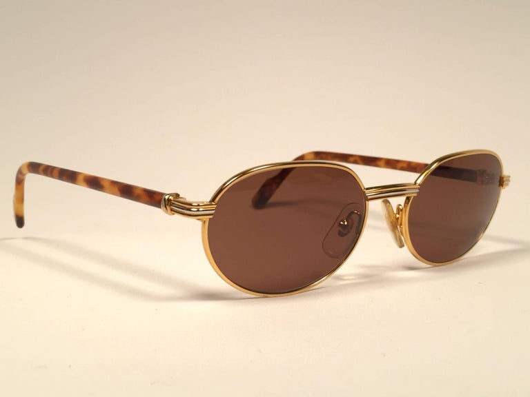 Women's or Men's New Cartier Classic Oval Lueur 51mm Gold Plated Sunglasses Made in France For Sale