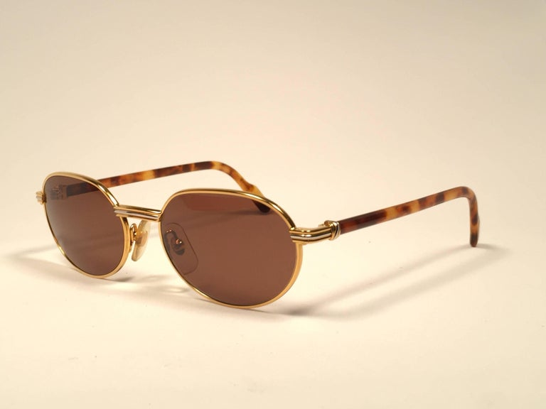 New Cartier Classic Oval Lueur 51mm Gold Plated Sunglasses Made in France For Sale 1