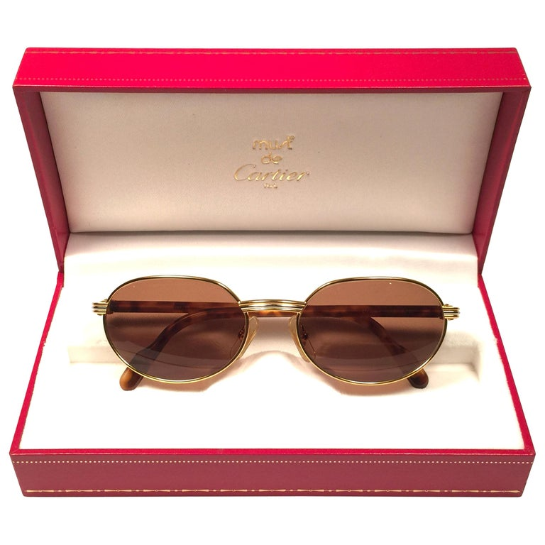 New Cartier Classic Oval Lueur 51mm Gold Plated Sunglasses Made in France For Sale