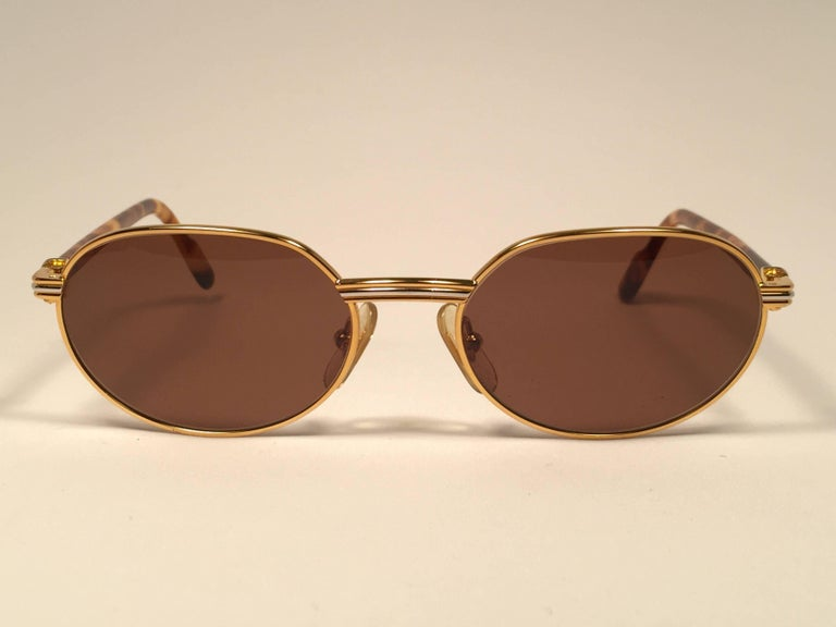 1abcbf49b28 Gray New Cartier Classic Oval Lueur 51mm Gold Plated Sunglasses Made in  France For Sale