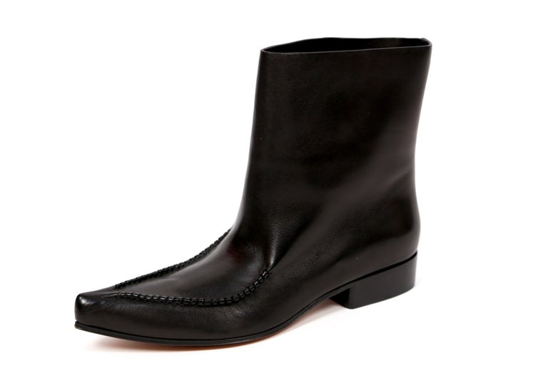 Black leather 'Santiago' ankle boots designed by Phoebe Philo for Celine. French size 40.5. Pointed toe. Pull on style. Approximate heel height is .75
