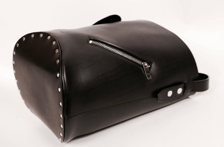 """Black leather 'biker bag' with silver studs and yellow suede lining designed by Phoebe Philo exactly as seen on the Celine spring 2016 runway. Bag is very large. It measures approximately: height 13"""", width 19"""" and handle drop is about 8"""". Bag has"""