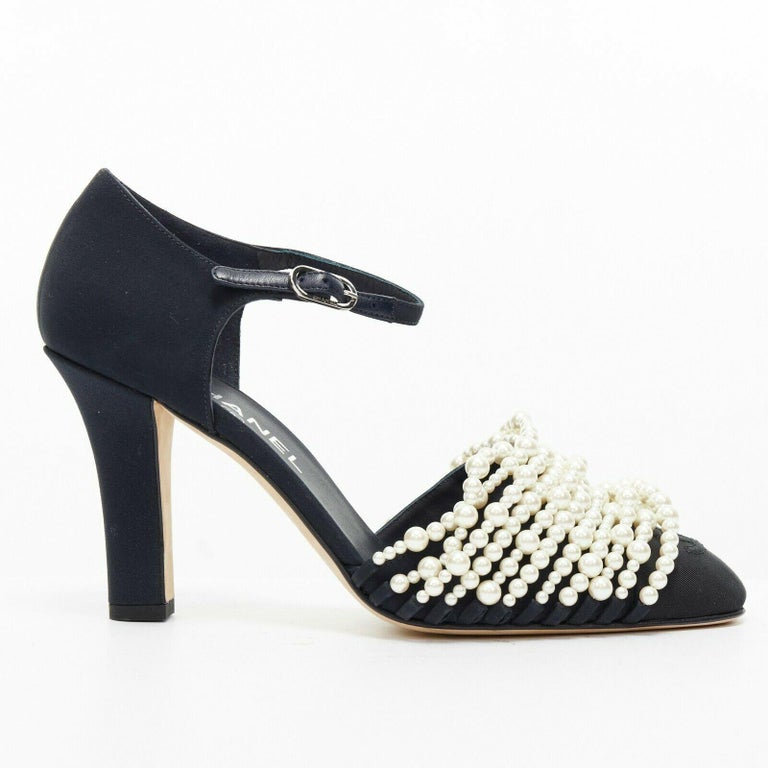 new CHANEL 17A navy multi pearl embellished CC satin toe ankle strap heels EU39  CHANEL FROM THE FALL WINTER 2017 COLLECTION Navy blue. Satin covered heel. Chunky heel. Ankle strap closure. Silver-tone Chanel signed buckle. White faux pearl strand
