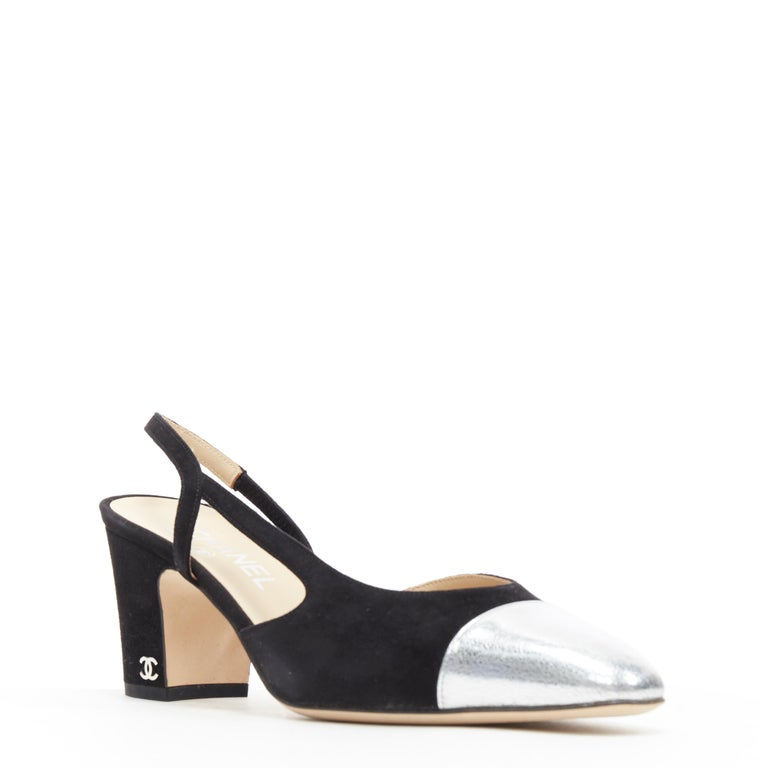 new CHANEL black suede silver toe cap CC logo mid block heel slingback pump EU39 Brand: Chanel Designer: Karl Lagerfeld Model Name / Style: Slingback pump Material: Suede Color: Black Pattern: Solid Extra Detail: Mid (2-2.9 in) heel height. Almond