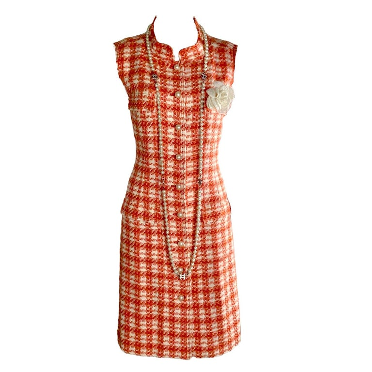 CHANEL tweed dress     Classic Chanel signature piece - a timeless classic that will last for many years     Beautiful colors - coral & ivory       Made in France     Dry Clean Only Size 40 Fashion jewelry not included