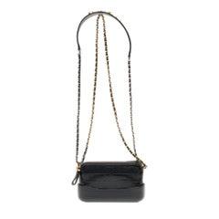 New-Chanel Mini Gabrielle shoulder bag in black calf embossed in crocodile style
