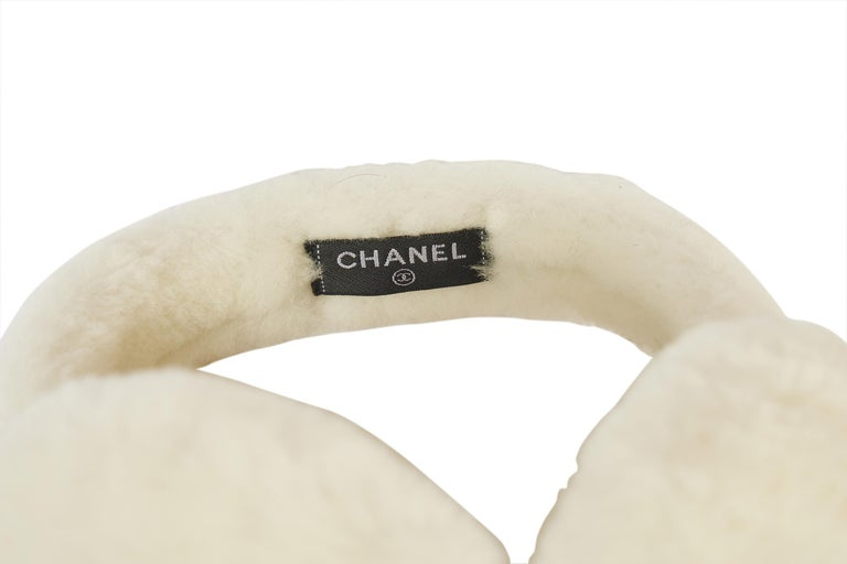 This super rare white Chanel ear muffs are sold out everywhere. They will keep you warm when you hit the slopes. This white piece has never been worn and comes in the original Chanel box. Both sides off the muffs show a big Chanel logo.