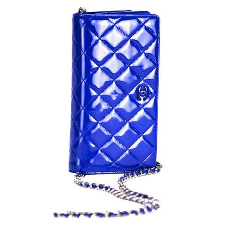 Chanel Rare Royal Blue Patent Leather WOC Crossbody Pristine  Year: 2014 So blue plated hardware Interior zippered pocket on flap Interior 6 card slot Interior large centered zipper pocket Additional large interior pocket Blue lambskin