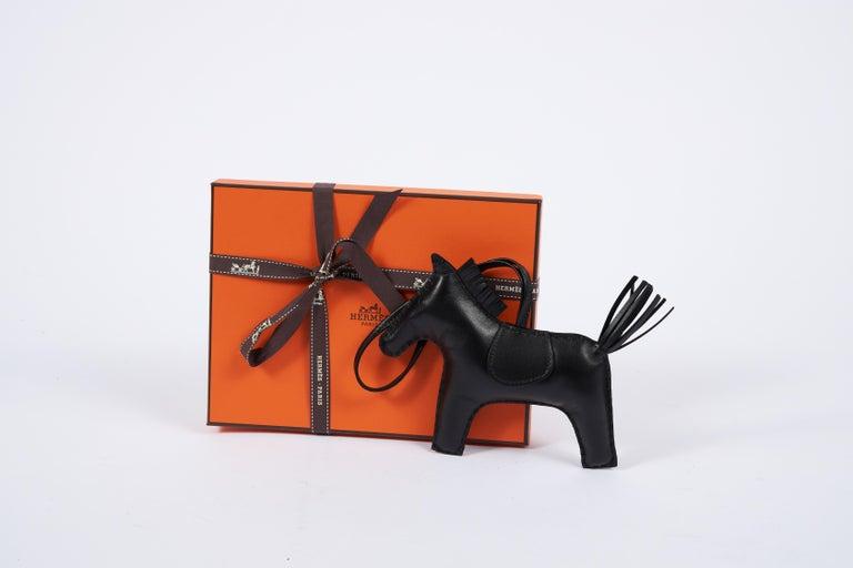 Hermes rare and collectible brand new in box large grigri roder all black swift leather charm. Comes with original box, ribbon and shopping bag.