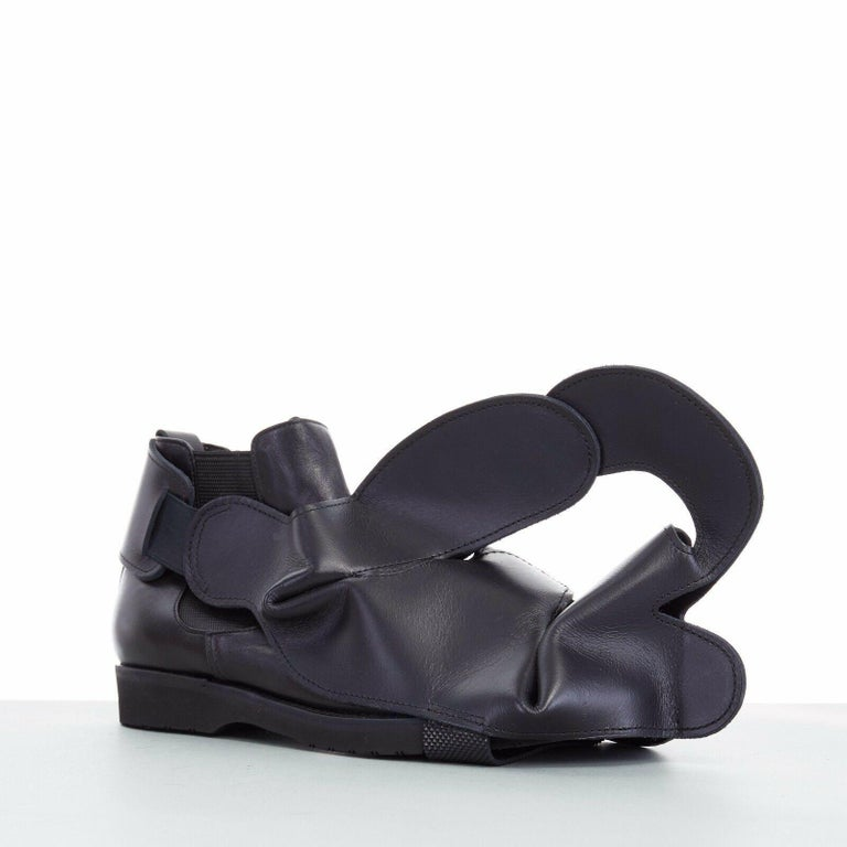 new COMME DES GARCONS SS14 rare black structured padded leather shoe cover  COMME DES GARCONS FROM THE SPRING SUMMER 2014 COLLECTION SUPER RARE AND HIGHLY COLLECTIBLE Black leather upper . Abstract structural constructed upper . Elasticated sling