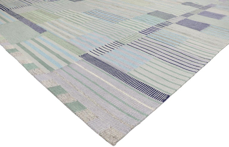 30636, new Contemporary Indo-Swedish Kilim rug with Bohemian Scandinavian Modern style. With its geometric design and bohemian hygge vibes, this hand-woven wool Swedish Indian Kilim rug beautifully embodies the simplicity of Scandinavian modern