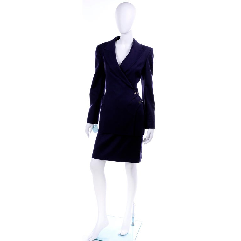 This is a vintage 1990's Claude Montana Paris navy blue wool skirt suit that still has its original tags attached and was never worn!  This deadstock outfit includes a slim skirt and a jacket with shoulder pads and front buckles & snaps.  The suit