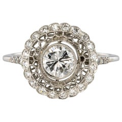 New Diamonds Platinum Round Engagement Ring