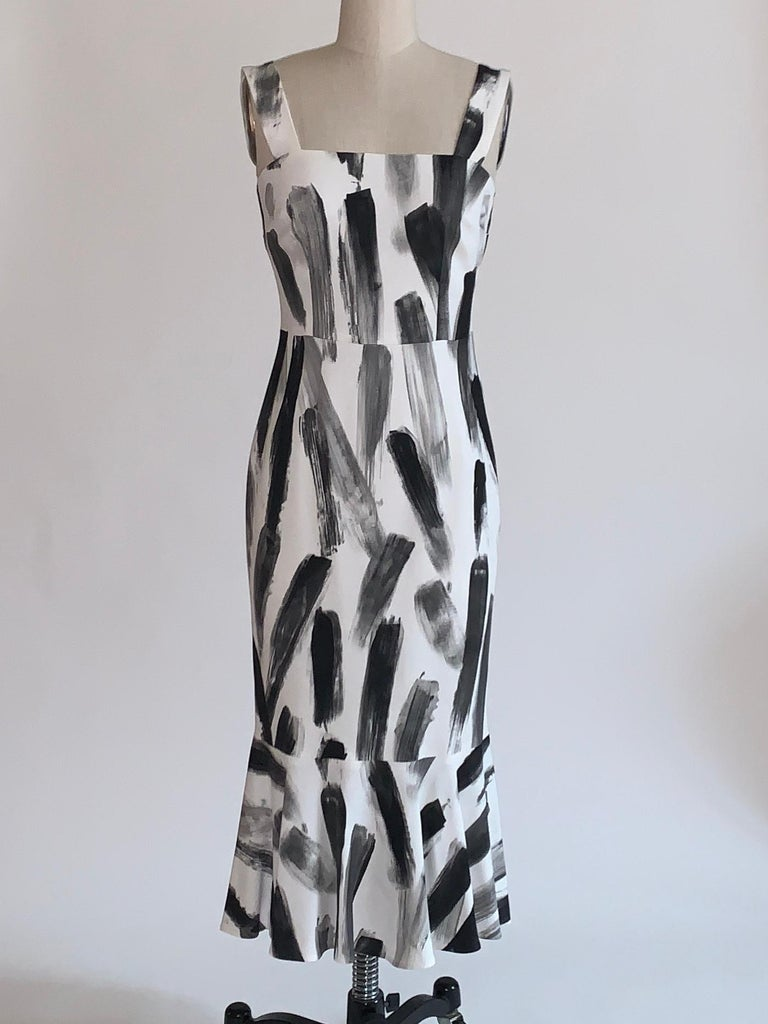 Dolce & Gabbana black and white brushstroke print sleeveless dress with flare hem as seen on the Spring 2016 runway, look 21. Back zip with hook and loop closure.  97% viscose, 3% elastane. Fully lined in 96% silk, 4% elastane.  Made in Italy.  Size