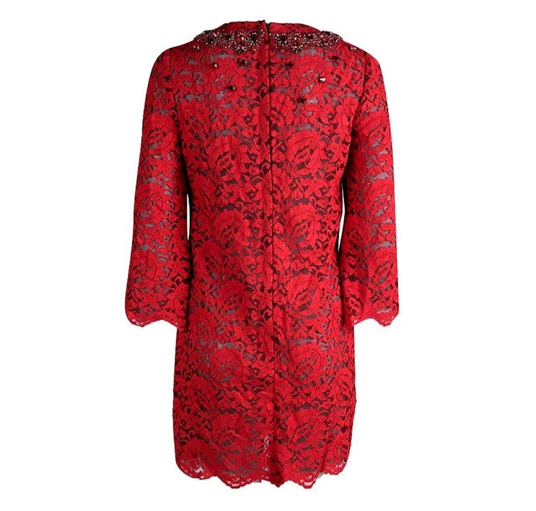 Beautifully cut from rich cardinal-red lace, Dolce & Gabbana hit a retro-inspired note with this thigh-grazing mini dress. A sprinkling of ruby crystals at the neckline catch the light, giving this elegant piece a dose of the label's glamorous