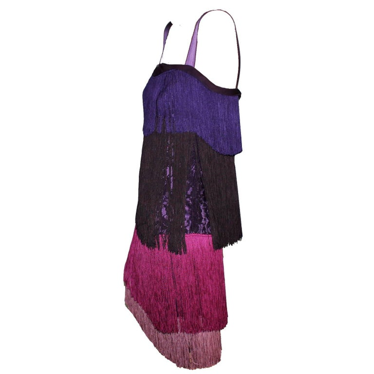 GORGEOUS DOLCE & GABBANA SILK FRINGE  DRESS  FLAPPER DRESS AS FROM THE MOVIE THE GREAT GATSBY    Made out of a purple lace fabric that shines through the fringes Purple underdress Colorblock fringes Size 40 Condition: Brandnew with tags Retail price