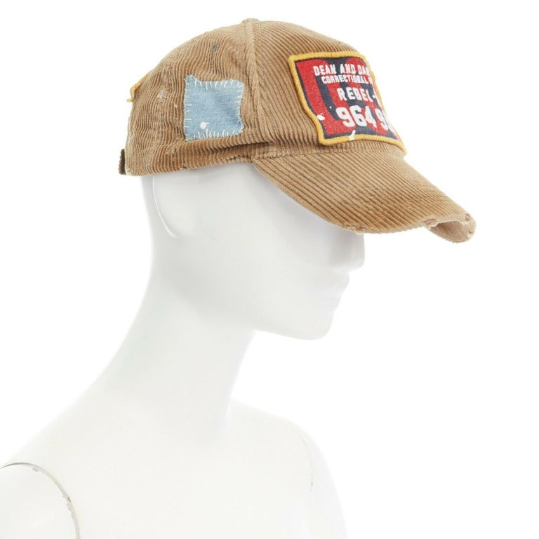 new DSQUARED2 D2 beige paint splattered logo badge distressed corduroy dad cap  DSQUARED2 BEIGE CORDUROY . PAINT SPLATTERED . LOGO BADGE . DISTRESSED . BASEBALL CAP . HAT  CONDITION Brand New with Tags  .MEASUREMENTS Length (top to front): 25.5cm /