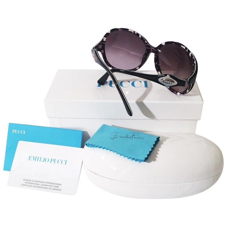 Emilio Pucci Sunglasses Brand New * Stunning Classic Pucci Sunglasses * Classic Black Frames * Pucci Print Interior: * Black, White & Light Pink * Silver Pucci Logo on Both Sides * Handmade ZYL in Italy * 100% UV Protection * Comes with Case,