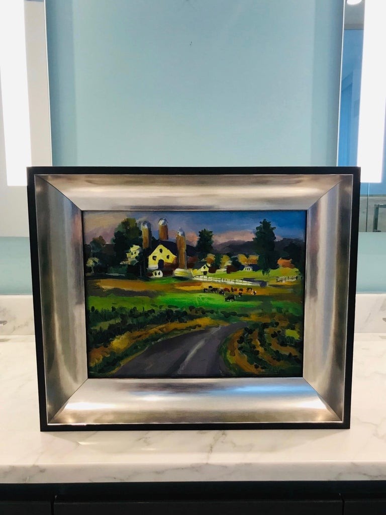 Outstanding contemporary impressionist landscape painting depicting a grassy road and acres of pasture with grazing cows, and a farm and hills in the background. Oil on board in custom shadow box frame with ebonized wood exterior and molded interior