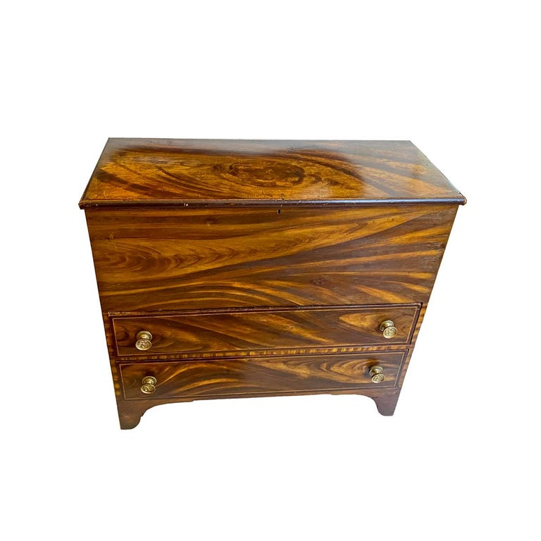 """Vibrantly painted, decorated with russet and mustard paint that simulates a faux mahogany color. Two bottom drawers with hinged thumb molded lift top. Original brass pulls. Original surface with crazing. New England, circa 1820 Measures: 39 ¼"""" x"""