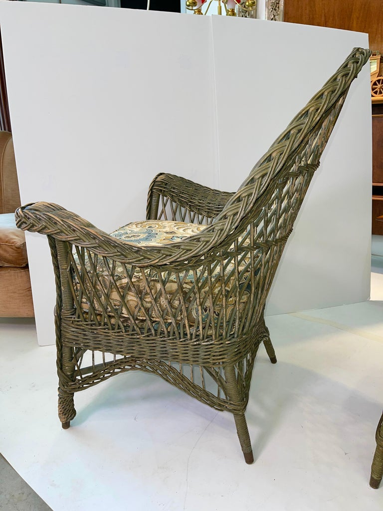 Early 20th Century New England Reed Co. Pair Wicker Armchairs and Ottoman For Sale