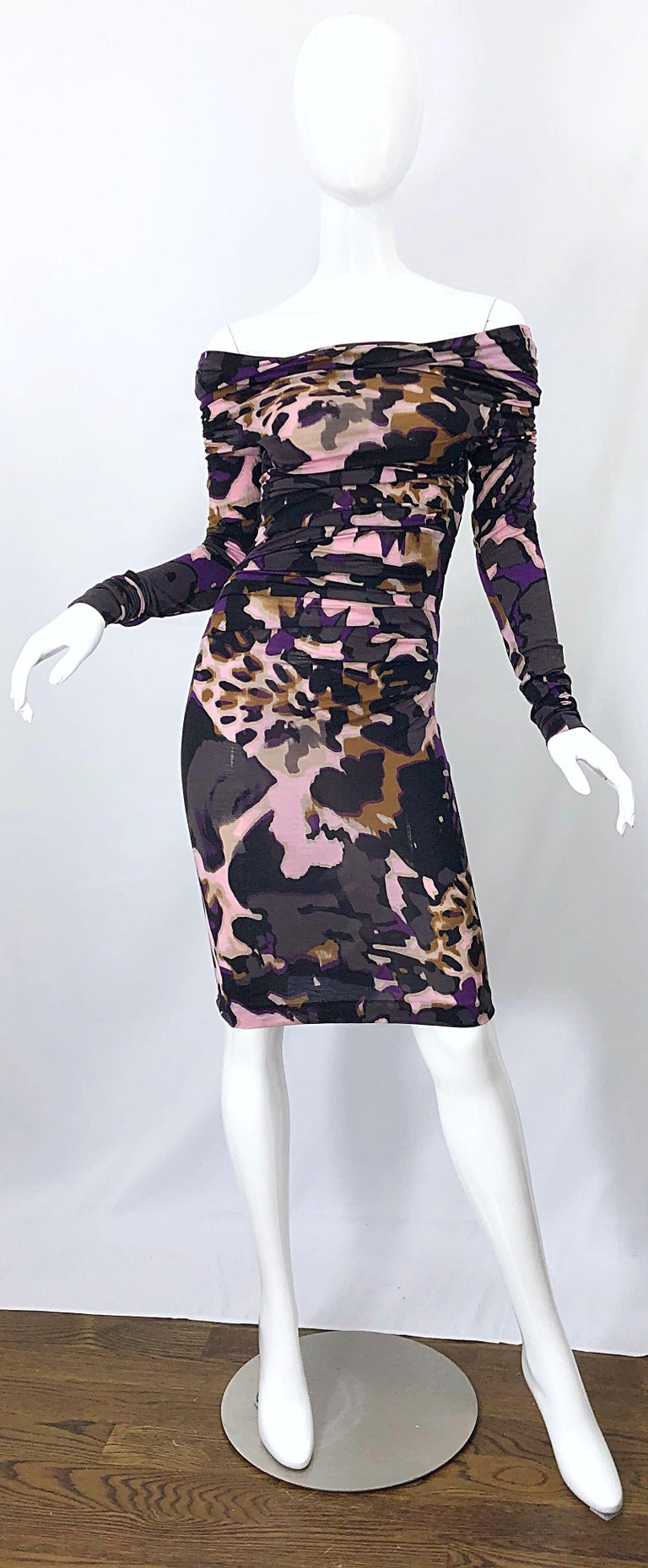 Incredible new ESCADA lightweight wool off-the-shoulder mixed animal print dress! Vibrant colors of purple, pink, gray, brown, rust and black throughout. Flattering ruching disguises any problem areas. The perfect lightweight fabric blends of wool