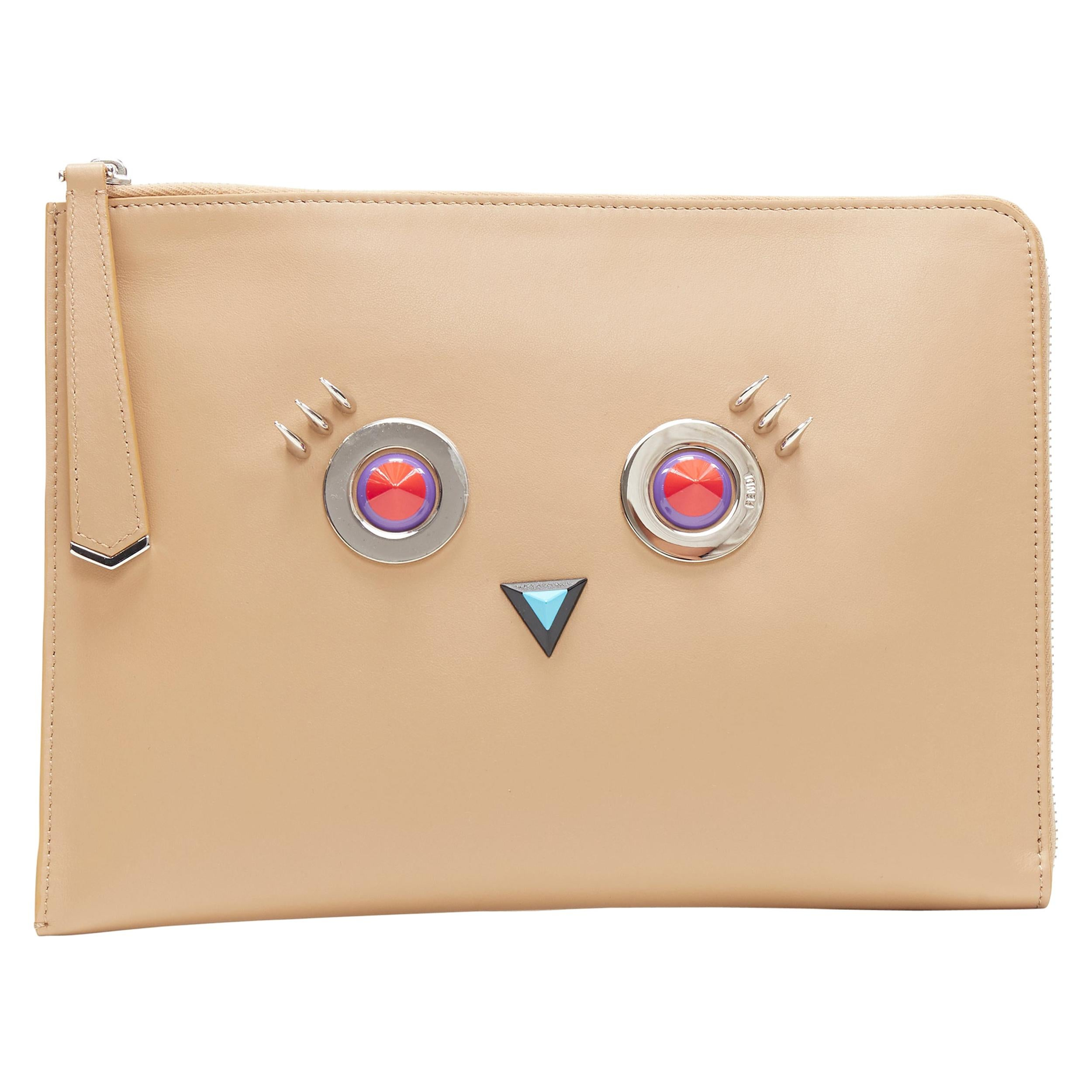new FENDI Monster Faces tan brown stud embellished zip around pouch clutch bag