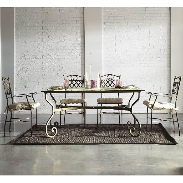 New garden, patio or dining table in wrought iron.  You can choose this pattern in round or rectangular table and then, choose the top (glass, mosaic, marble, ceramic...) and color finished.   The price it´s only for the legs structure, you can