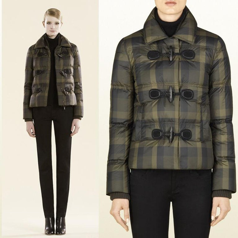 Gucci Size: IT 40 Brand New  $2295  Olive green, Hunter green & Black Plaid Amazing attention to detail & Very Warm Lightweight double Layered Interior Zippered Vest Buttons Down the Front Toggle closures at center front Warm Lined Pockets Knit