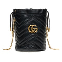 New GUCCI mini bucket bag GG Marmont in black quilted leather with chevrons