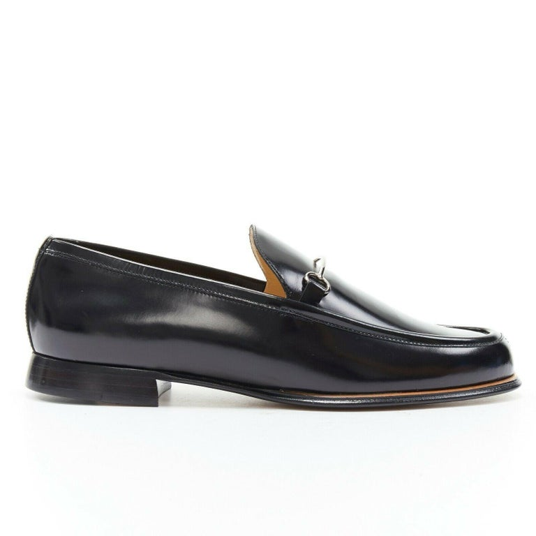new GUCCI Vintage black leather silver minimal horsebit slip on loafer EU36.5C  GUCCI VINTAGE Black polished leather upper. Silver-tone minimal horsebit detail. Almond round toe. Tonal stitching. Stacked wood block heel. Slip on loafer. Made in