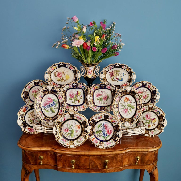 This is a very striking and rare dessert service made by New Hall between 1824 and 1830. The service consists of 12 plates, 2 one-handled serving dishes, 2 square serving dishes, and 4 oval serving dishes.   I have a smaller set available by the