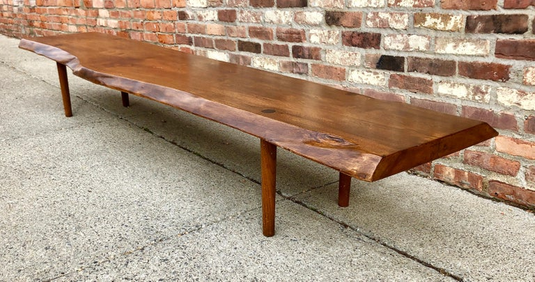 Nakashima style long bench with free-edge and thru-tenon details,circa 1960s.Nice old linseed oil finish. Unsigned.