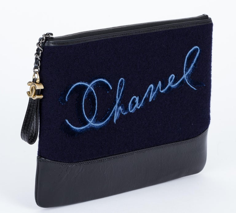 Chanel brand new in box navy blue and black Paris Salzburg clutch. Leather and felt accent. Comes with hologram, id card, booklet, dust cover, camellia, ribbon and box.