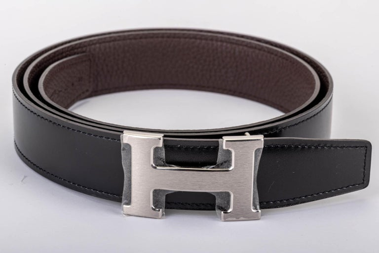 Hermès medium constance belt with reversible leather. Black box and brown togo. Palladium satin buckle. Size 95 cm. Blind Stamp T for 2016. Brand new, comes with original box and dust cover.