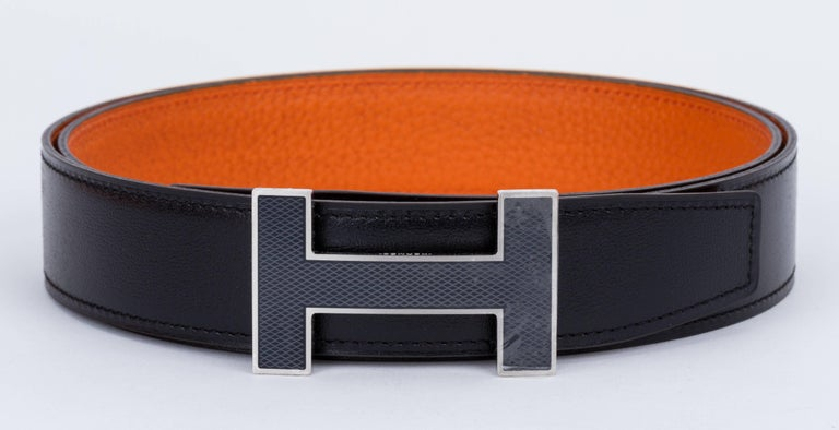 Hermes BNIB reversible unisex H belt, black box calf leather and orange togo. Black enamel and palladium H buckle. Date stamp A for 2017. European size 95. Comes with dust cover, box, ribbon and dust bag.