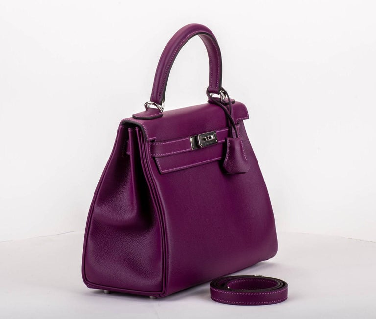 Hermes brand new in box kelly 28 retourne anemone evercalf with palladium tone hardware. Date stamp D for 2019. Comes with clochette, tirette, lock, keys, dust cover, booklet, rain jacket, box, ribbon.