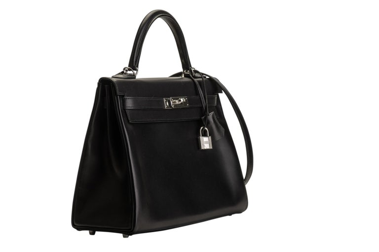 Hermes brand new in box Kelly 32 retourne in black ever calf skin with palladium hardware. Comes with full set: couchette, tire, lock, keys, booklet, rain jacket, box, ribbon and dust cover.