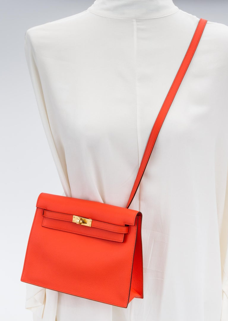 Hermes brand new in box feu evercolor kelly danse with gold tone hardware. The best and newest reissue of the Hermes collection, can be worn as a fanny pack, a clutch or a cross body. Blind stamp Y for 2020. Comes with booklet, felt, blacked out