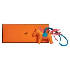 New in Box Hermès Orange Rodeo Grigri Bag Charm