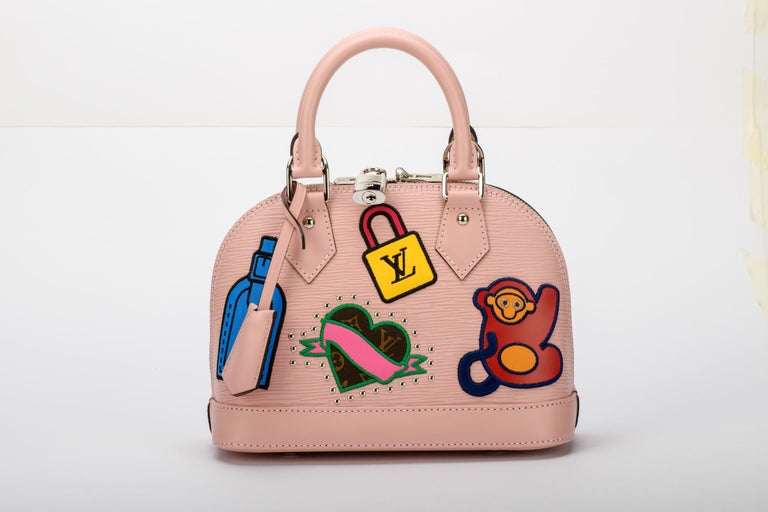Louis Vuitton limited edition baby pink epi small alma bag with colorful stickers. Handle drop 10cm, shoulder strap 113cm. Comes with lock and 2 keys, dust cover, booklet and box.