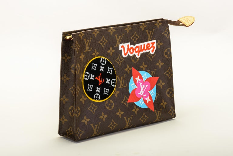 Louis Vuitton limited edition travel stickers pouchette. Sold out everywhere. Comes with dust cover and box.