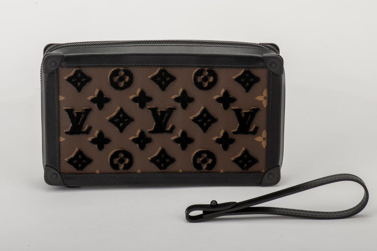 Louis Vuitton runway spring summer 2020 clutch with detachable wristlet. Coated monogram canvas with raised black velvet letters. Brand new, comes with dust cover and box.