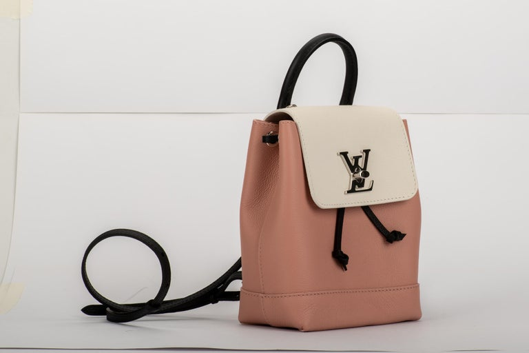 Louis Vuitton SOLD OUT limited edition lockme mini backpack in tricolor leather and shiny silver hardware. Pink, black and white combo.Very versatile and young can be worn also as cross body. Brand new, comes with dust cover , box and shopper.