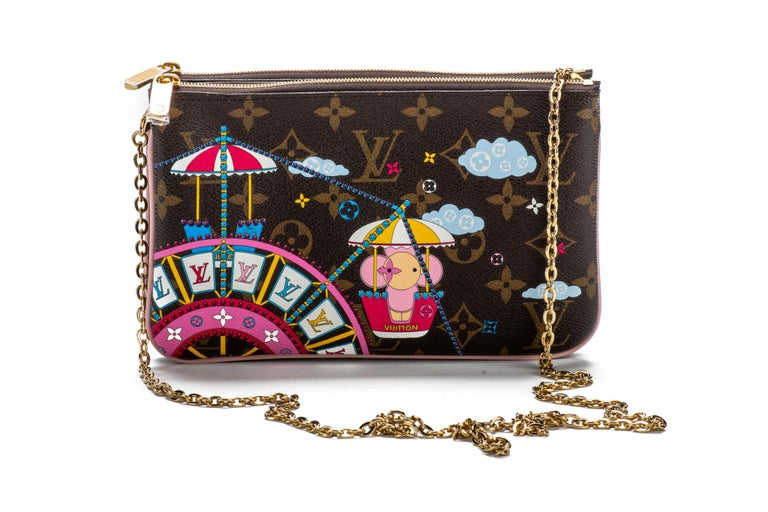 Louis Vuitton limited edition double pochette in coated monogram canvas with Ferris Wheel 2020 Christmas design. Double zipped compartments with middle open pocket, can be used as a pochette or as a cross body. Comes with original dust cover and