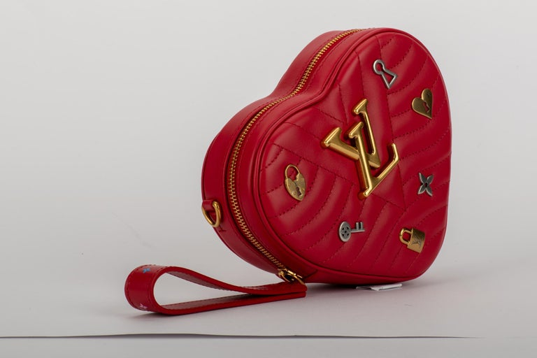 Louis Vuitton limited edition heart shape red leather bag with logo silver and gold charms. Can we born as a clutch, waist bag or cross body bag. Shoulder strap 20