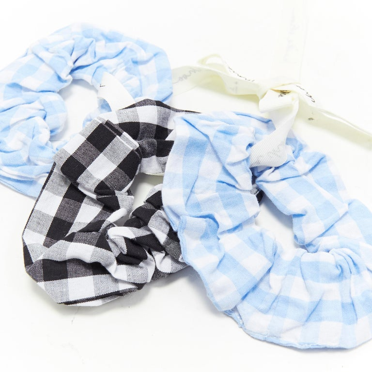 new INNIKA CHOO 3 pack black blue gingham checkered scrunchie hair tie bracelet Brand: Innika Choo Designer: Innika Choo Model Name / Style: Scrunchie Material: Fabric Color: Blue Pattern: Check  CONDITION:  Condition: New with tags.     We are a