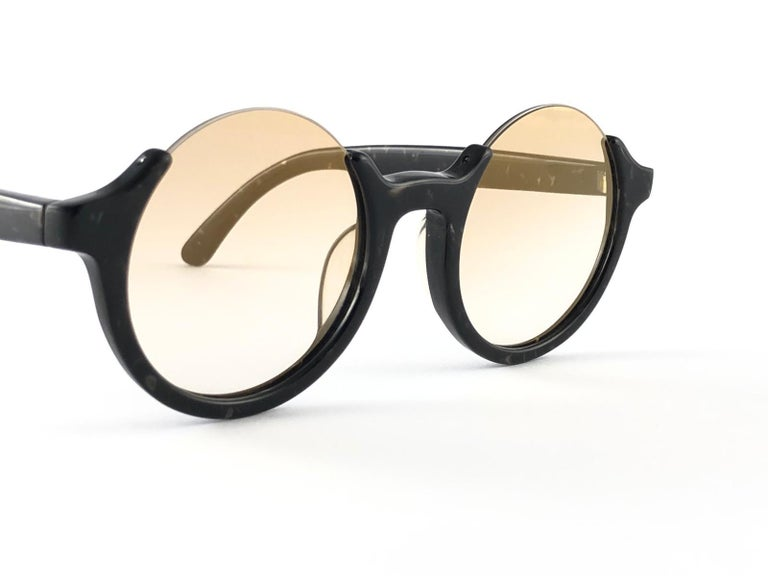 New Jean Paul Gaultier 56 7061 round black marbled frame.  Flat lenses that complete a ready to wear JPG look. Amazing quality and design. A piece of sunglasses history. This pair has minor sign of wear due to nearly 30 years of storage.  Design