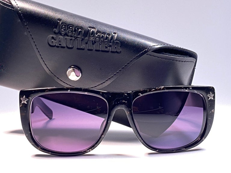 New Collectors Item!!  New Iconic Jean Paul Gaultier 56 8272 Black marbled Silver Matte temples frame.  Dark blue lenses that complete a ready to wear JPG look. The very same model worn by Vanilla Ice in 1990's. Amazing design with strong yet